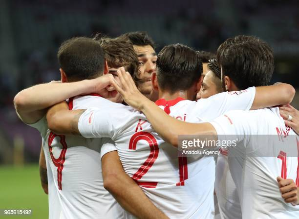Cenk Tosun of Turkey celebrates with his teammates after scoring during the friendly football match between Tunisia and Turkey at Stade de Geneve in...