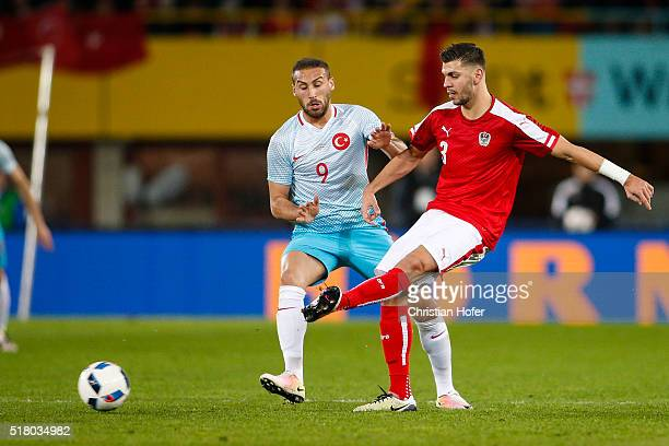 Cenk Tosun of Turkey competes for the ball with Aleksandar Dragovic of Austria during the international friendly match between Austria and Turkey at...
