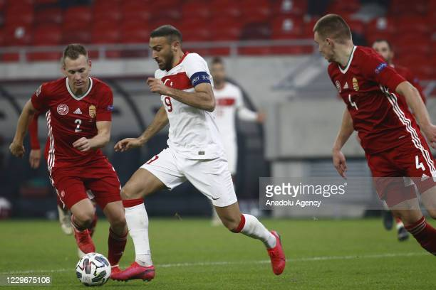Cenk Tosun of Turkey in action against Adam Lang of Hungary during the UEFA Nations League match between Hungary and Turkey at Puskas Arena in...
