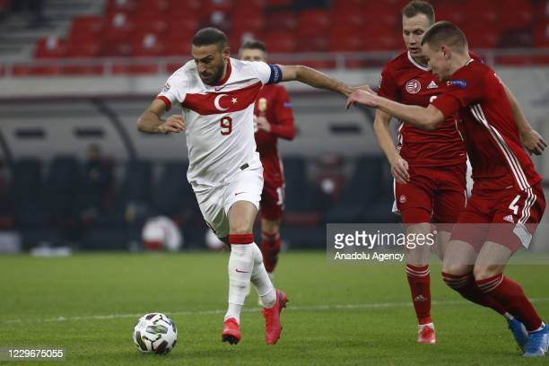 Cenk Tosun of Turkey in action against Attila Szalai of Hungary during the UEFA Nations League match between Hungary and Turkey at Puskas Arena in...