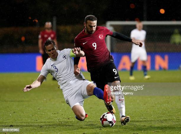 Cenk Tosun of Turkey in action against Niklas Moisander of Finland during the 2018 FIFA World Cup European Qualification Group I match between...
