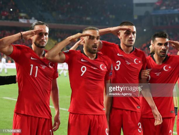 Cenk Tosun of Turkey salute with his teammates after scoring a goal during the UEFA Euro 2020 Qualifying round Group H group match between Turkey and...