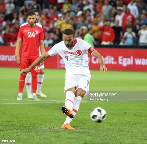 Cenk Tosun of Turkey shoots a penalty during the friendly football match between Tunisia and Turkey at Stade de Geneve in Geneva Switzerland on June...