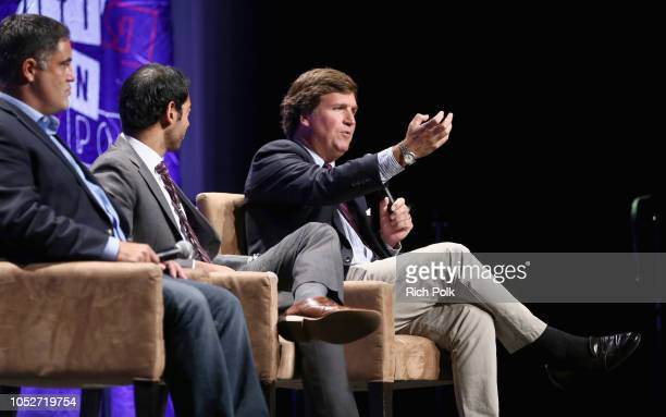 Cenk Uygur, Steven Olikara, and Tucker Carlson speak onstage during Politicon 2018 at Los Angeles Convention Center on October 21, 2018 in Los...