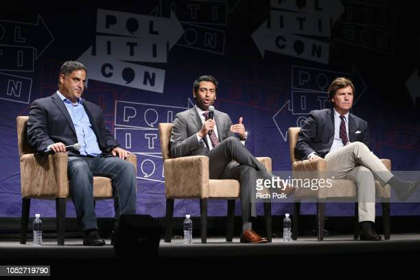 Cenk Uygur Steven Olikara and Tucker Carlson speak onstage during Politicon 2018 at Los Angeles Convention Center on October 21 2018 in Los Angeles...