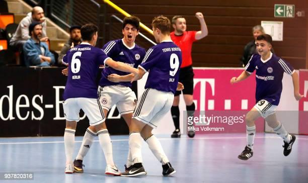 Cenker Yoldas of Berlin celebrates scoring a goal with teammates during the final of the DFB Indoor Football match CJunioren between Tennis Borussia...