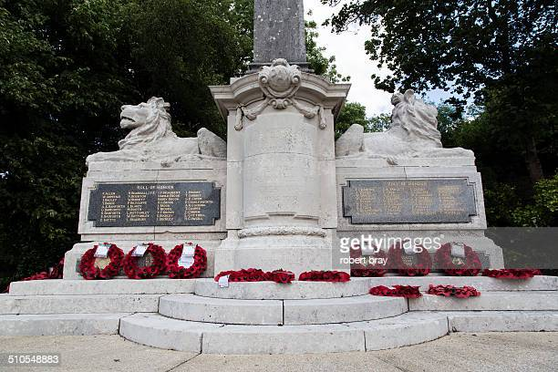 Cenotaph in a park with poppy wreaths.
