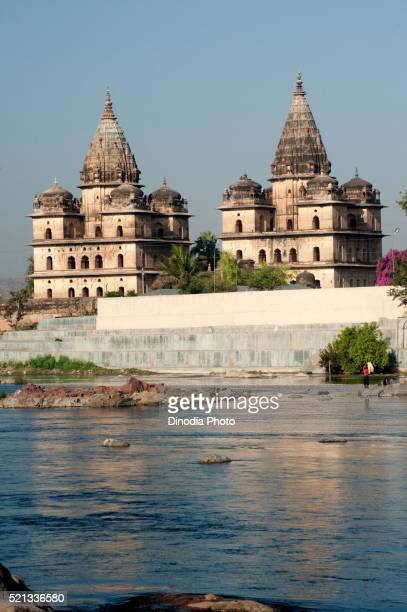 cenotaphs on bank of betwa river, orchha, tikamgarh, madhya pradesh, india - madhya pradesh stock pictures, royalty-free photos & images