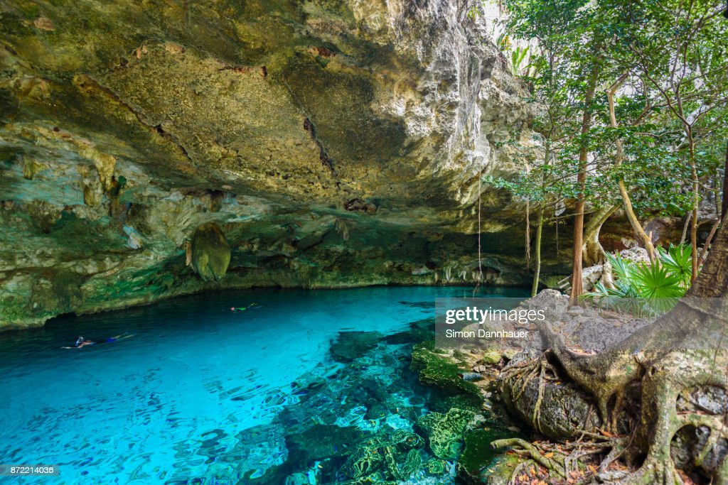 Cenote Dos Ojos in Quintana Roo, Mexico. People swimming and snorkeling in clear blue water. This cenote is located close to Tulum in Yucatan peninsula, Mexico. : Stock Photo