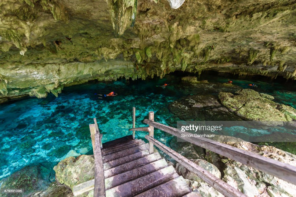 Cenote Dos Ojos in Quintana Roo, Mexico. People swimming and snorkeling in clear water. This cenote is located close to Tulum in Yucatan peninsula, Mexico. : Stock Photo