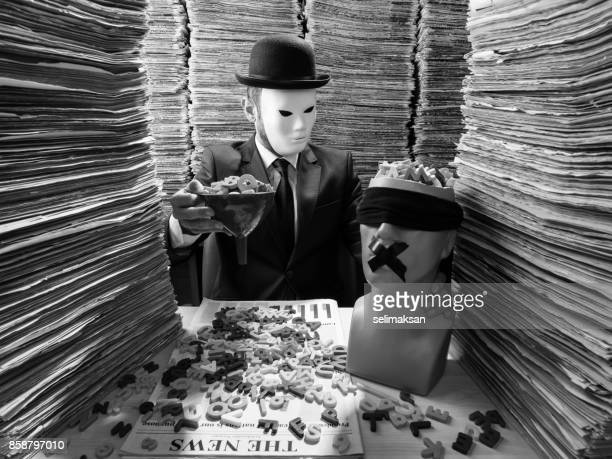 censor agent reading newspaper in media library for censorship - conspiracy stock pictures, royalty-free photos & images