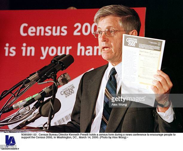 Census Bureau Director Kenneth Prewitt holds a census form during a news conference to encourage people to support the Census 2000 in Washington DC...