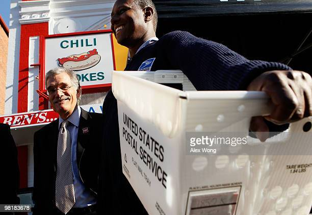 S Census Bureau Director Robert Groves and Karl Griffis of the US Postal Service wait for people to drop off their completed census forms during an...