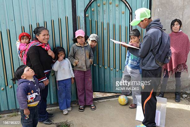 Census enumerator asks questions to a family at El Alto in La Paz, during a national census day on November 21, 2012. Bolivia is taking of a census...