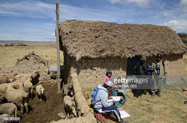 A census enumerator asks questions to an aymara family at the Wichi Wichi community 40 Km from La Paz in the Bolivian high plateau during a national...