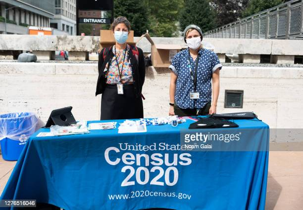 Census workers stand outside Lincoln Center for the Performing Arts as the city continues Phase 4 of re-opening following restrictions imposed to...