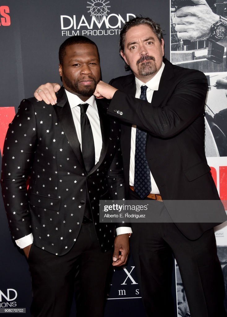50 Cent and Christian Gudegast attend the premiere of STX Films' 'Den of Thieves' at Regal LA Live Stadium 14 on January 17, 2018 in Los Angeles, California.