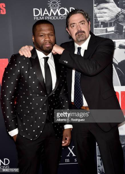 Cent and Christian Gudegast attend the premiere of STX Films' Den of Thieves at Regal LA Live Stadium 14 on January 17 2018 in Los Angeles California