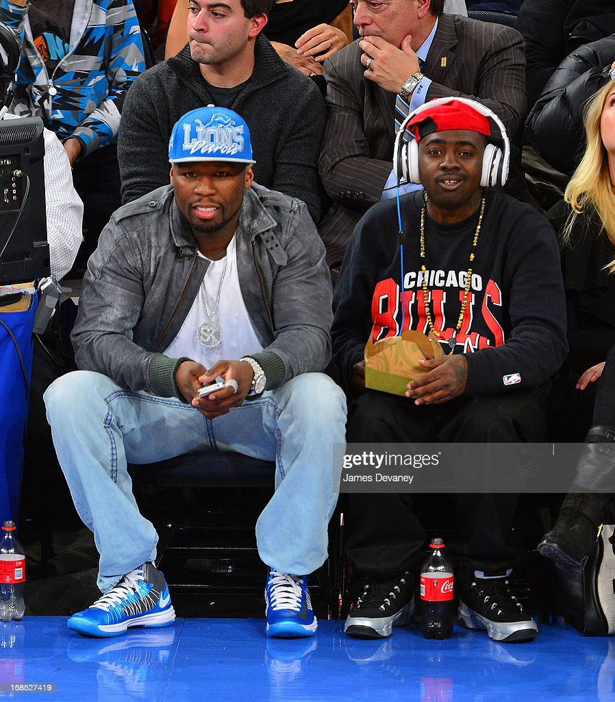 50 Cent and guest attend the Houston Rockets vs New York Knicks game at Madison Square Garden on December 17, 2012 in New York City.