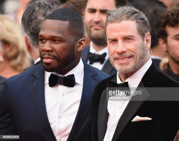 Cent and John Travolta attend the screening of 'Solo A Star Wars Story' during the 71st annual Cannes Film Festival at Palais des Festivals on May 15...