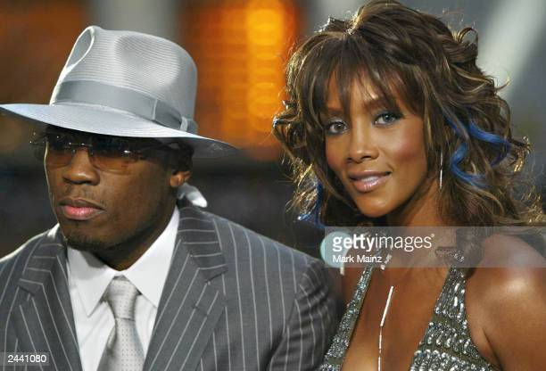 Cent and Vivica A Fox during the preshow interviews on the MTV News Platform at the 2003 MTV Video Music Awards at Radio City Music Hall on August 28...