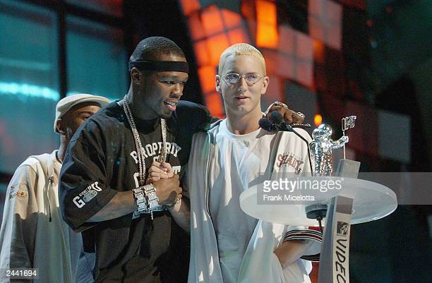 Cent congratulates Eminem for receiving the award for Best Video From A Film during the 2003 MTV Video Music Awards at Radio City Music Hall on...