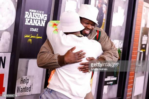 "Cent hugs Mekai Curtis attends the ""Power Book lll: Raising Kanan"" New York Premiere at Hammerstein Ballroom on July 15, 2021 in New York City."