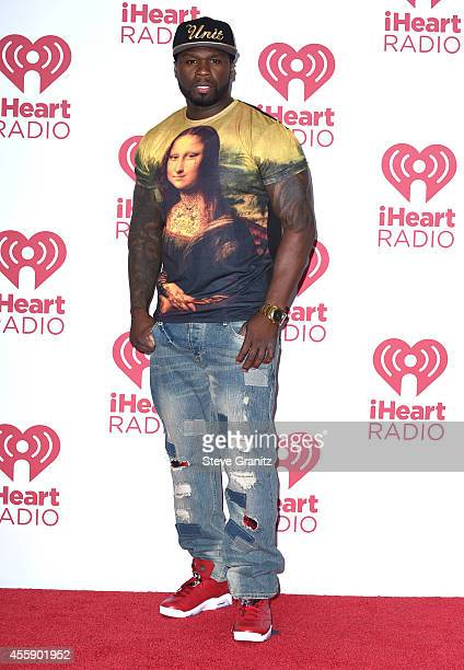 Cent poses in the 2014 iHeartRadio Music Festival Night 2 Press Room at MGM Grand Garden Arena on September 20 2014 in Las Vegas Nevada
