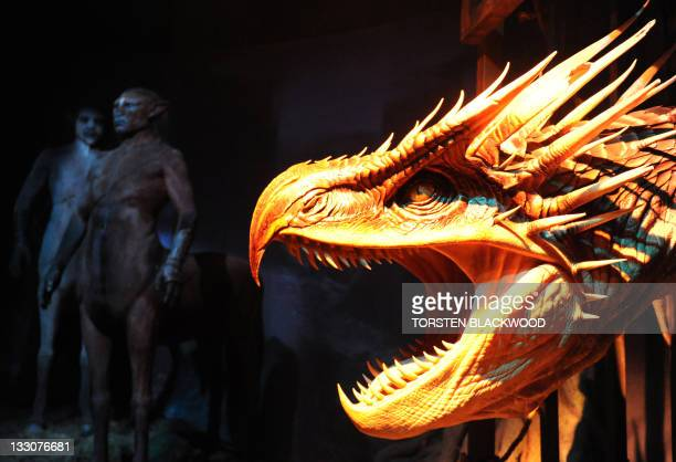 Centaurs stand near a model of a Hungarian horntail dragon during the opening of the Harry Potter exhibition at the Powerhouse Museum in Sydney on...