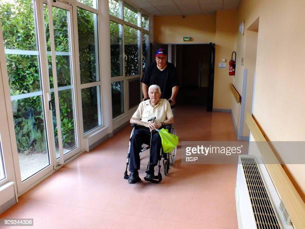 Centenarian arriving at hospital.