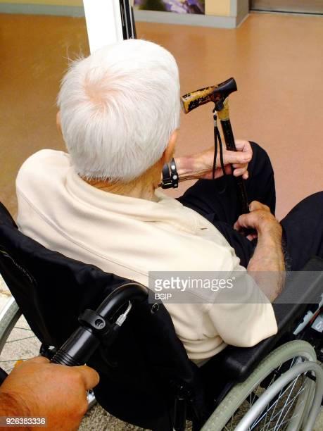 Centenarian going into a hospital.