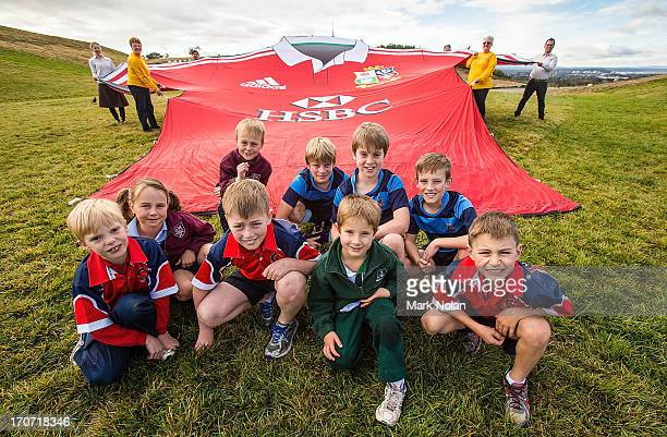 Centenary of Canberra Volunteers National Arboretum volunteers and local rugby juniors hold the giant British Irish Lions shirt at the National...