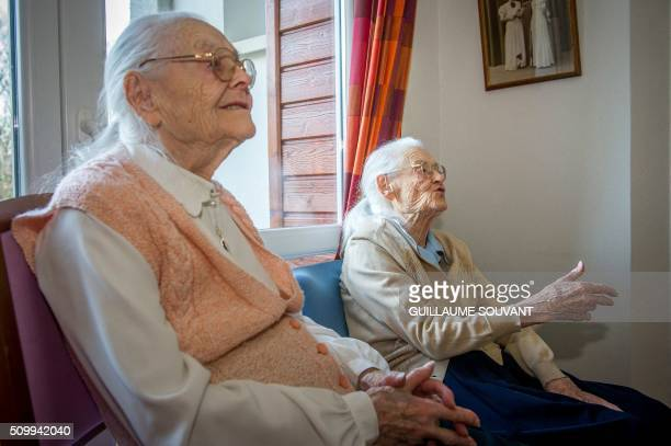 """Centenary twins, Paulette Olivier and Simone Thiot sit and talk inside their room at the retirement home """"Les Bois Blancs"""" on February 11, 2016. -..."""