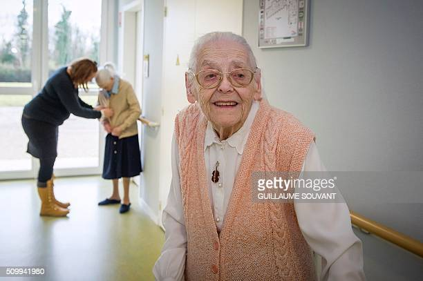 """Centenary twins, Paulette Olivier poses in a corridor at the retirement home """"Les Bois Blancs"""" on February 11, 2016. The twins, birth name Lamolie,..."""