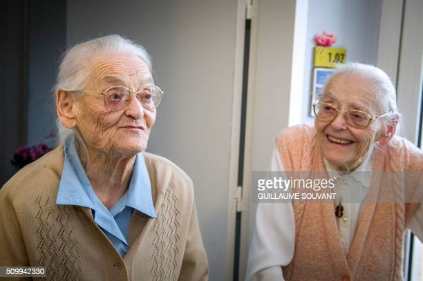 """Centenary twins, Simone Thiot and Paulette Olivier , smile inside the retirement home """"Les Bois Blancs"""" on February 11, 2016. - The twins, birth name..."""