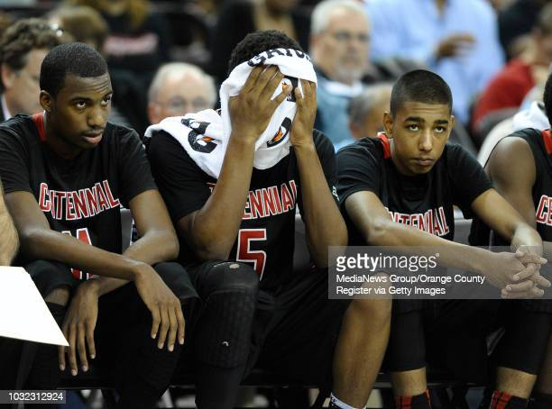 Centennial's Jordan Griffin Khalil Ahmad and Jalen Wiltz from left watch from the bench as the Huskies lose 6655 to Monte Vista in the CIF Boys Div I...