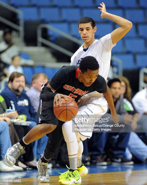 Centennial's Khalil Ahmad drives around CH's Lonzo Ball at Citizens Business Bank Arena in Ontario CA on Saturday March 22 2014 Chino Hills vs...