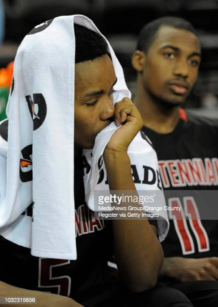 Centennial's Khalil Ahmad left and Jordan Griffin sit on the bench after the Huskies' 6655 loss to the Mustangs in the CIF Boys Div I North...