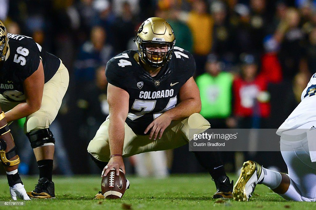 Center Alex Kelley #74 of the Colorado Buffaloes prepares to snap the ball against the UCLA Bruins in the first quarter at Folsom Field on November 3, 2016 in Boulder, Colorado.