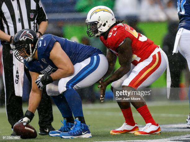 Center Alex Mack of the Atlanta Falcons from the NFC Team hikes the ball to Defensive End Melvin Ingram of the Los Angeles Chargers from the AFC Team...