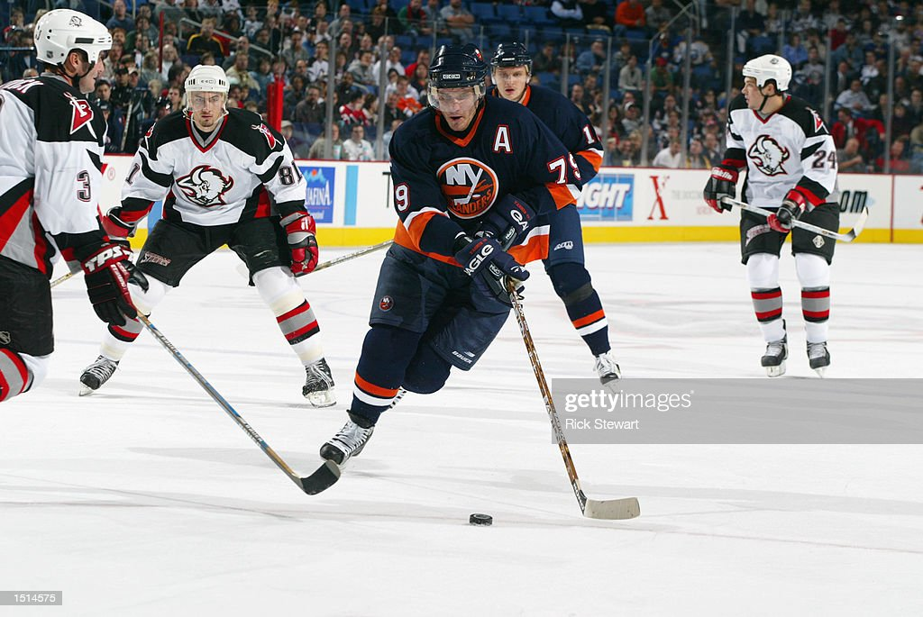 Center Alexei Yashin #79 of the New York Islanders skates with the puck while being defended by James Patrick #3 of the Buffalo Sabres during the NHL game on October 10, 2002 at HSBC Arena in Buffalo, New York. The Sabres defeated the Islanders 5-1.