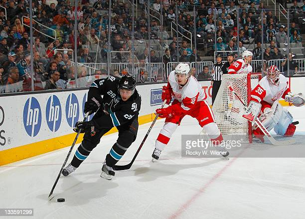 Center Andrew Murray of the San Jose Sharks controls the puck against defenseman Brendan Smith of the Detroit Red Wings at the HP Pavilion on...