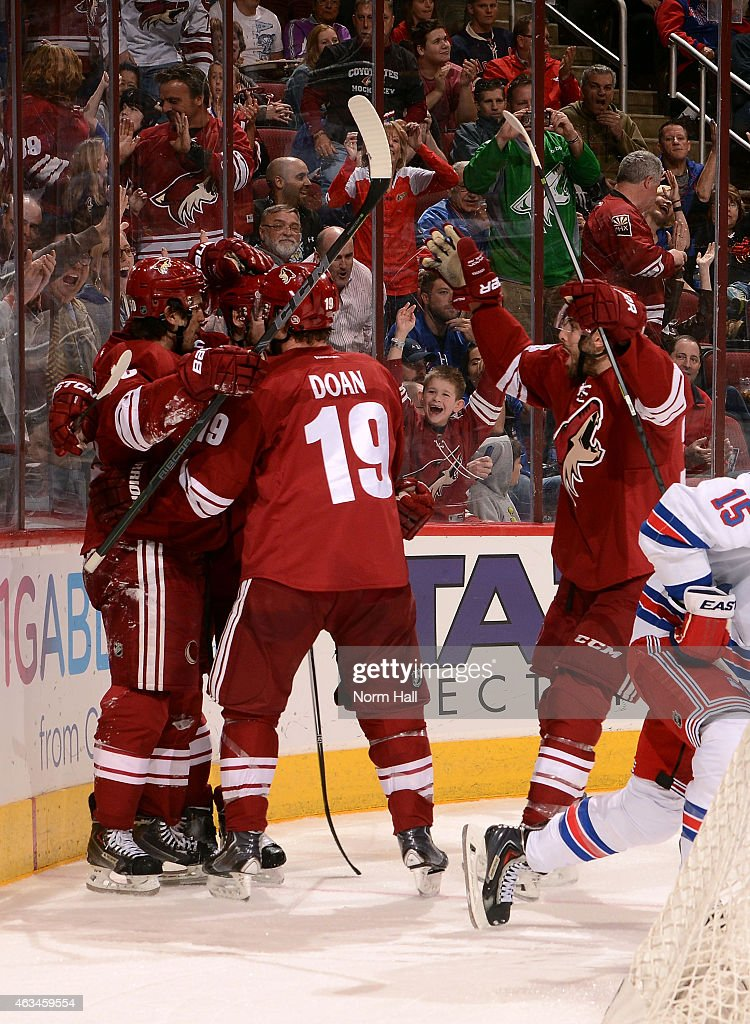 Center Antoine Vermette #50 of the Arizona Coyotes (left) celebrates his second period goal with right wing Shane Doan #19 (center) during the NHL game against the New York Rangers at Gila River Arena on February 14, 2015 in Glendale, Arizona.