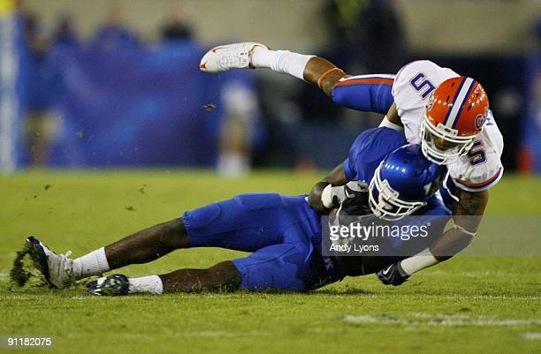 Center back Joe Haden of the Florida Gators tackles wide receiver Chris Matthews of the Kentucky Wildcats during the third quarter of the game at...