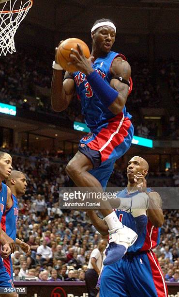 Center Ben Wallace of the Detroit Pistons pulls down one of his 21 total rebounds in front of teammate Chauncey Billups against the Milwaukee Bucks...