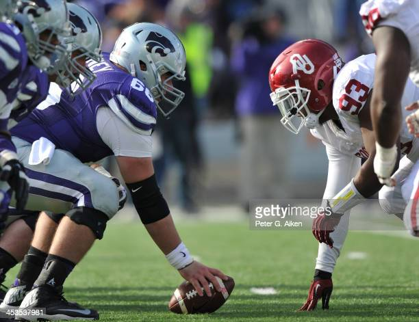 Center BJ Finney of the Kansas State Wildcats gets set to snap the ball against nose tackle Jordan Wade of the Oklahoma Sooners during the second...
