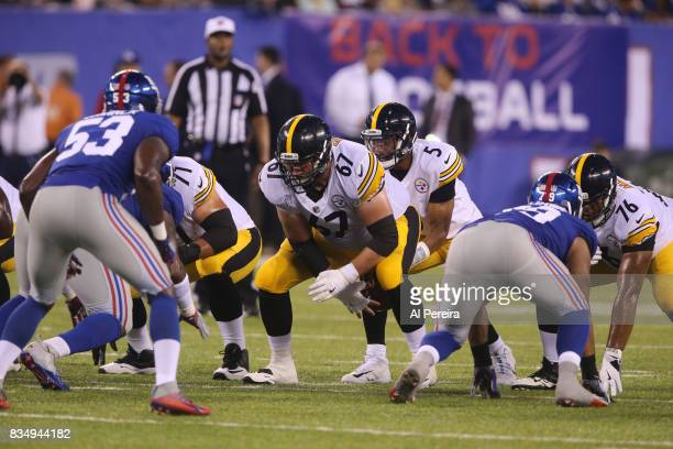 Center BJ Finney of the Pittsburgh Steelers blocks against the New York Giants during an NFL preseason game at MetLife Stadium on August 11 2017 in...