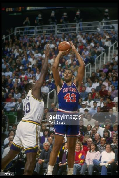 Center Brad Daugherty of the Cleveland Cavaliers prepares to shoot the ball during a game against the Utah Jazz at the Delta Center in Salt Lake...