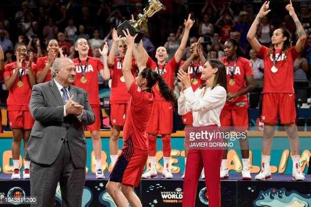 US' center Breanna Stewart raises the world cup trophy between Spain's queen Letizia and FIBA president Horacio Muratore as she celebrates winning...