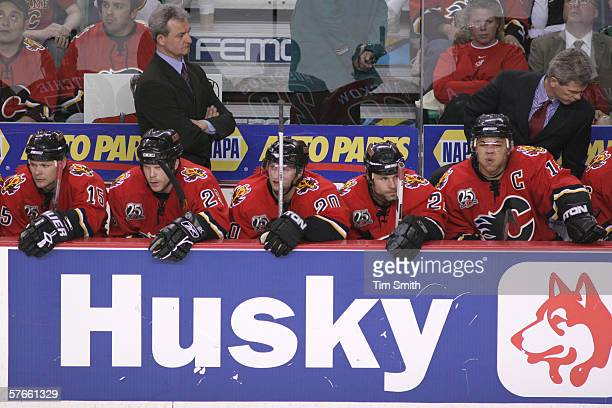 Center Byron Ritchie of the Calgary Flames sits next to his teammates center Craig MacDonald right wing Kristian Huselius center Daymond Langkow and...